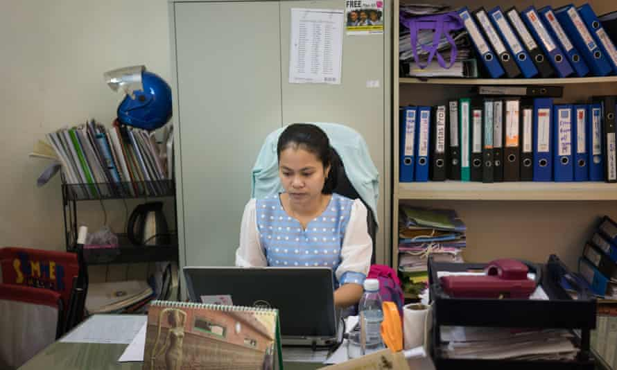 Chhan Sokunthea, head of the women and children's division in her office at Adhoc
