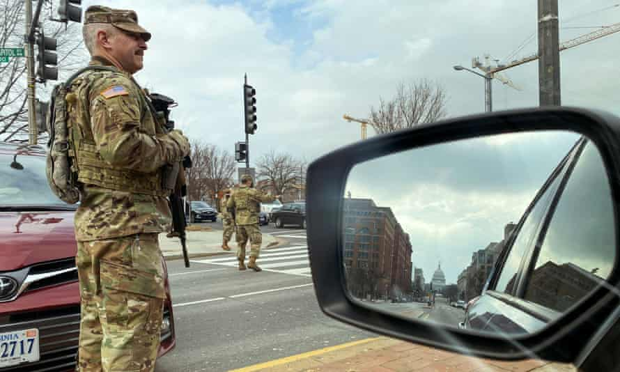 US national guard soldiers staff a checkpoint a few blocks from the Capitol. Security measures have been dramatically strengthened.