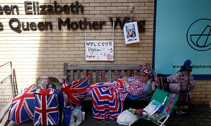 A fan of Britain's royal family camps outside the hospital where the Duchess of Cambridge is due to give birth.