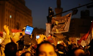 "An opposition supporter holds up a laptop showing images of celebrations in Cairo's Tahrir Square, after Egypt's President Hosni Mubarak resigned February 11, 2011. Mubarak stepped down as president of Egypt on Friday after 30 years of rule, handing power to the army and bowing to relentless pressure from a popular uprising after his military support. ""New media, mainly satellite channels, have managed to spread the message of the revolution everywhere, including rural areas,"" said Abdel Fattah of the Al Ahram Centre for Political and Strategic Studies and social networking sites such as Twitter and Facebook have been a key means of communications for the protesters. REUTERS/Dylan Martinez (EGYPT - Tags: MEDIA CIVIL UNREST POLITICS SCI TECH)"