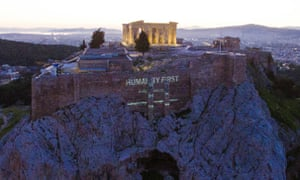 'Humanity first': a message to European leaders is projected on to the Acropolis
