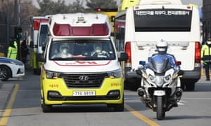 Police escort ambulances carrying South Korean citizens repatriated from the Chinese city of Wuhan.