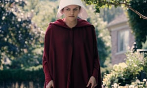 Offred, played by Elisabeth Moss, struggles to survive in The Handmaid's Tale.