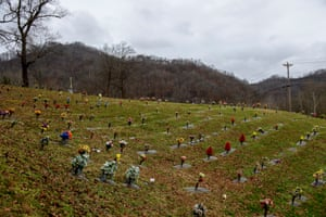 Fake flowers mark graves on a hillside in Pikeville, Kentucky.