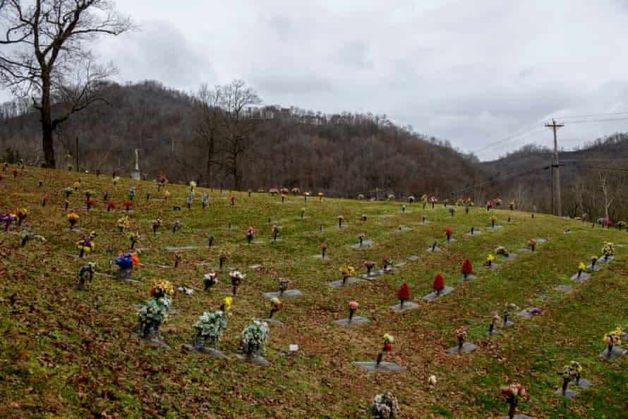 Fake flowers mark graves on a hillside in Pikeville, Kentucky.