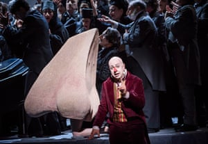 Martin Winkler, 'breathless in a burgundy suit' as Kovalov in The Nose.