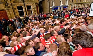Ball's up or doon? Residents of Kirkwall, Orkney, enjoy the rough and tumble of the Ba' game.