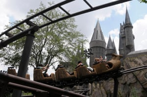 The Flight of the Hippogriff ride passes Hogwarts castle at the Universal Studios Wizarding World of Harry Potter theme park in Orlando, Florida.