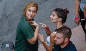 Amy Schumer (left) and Emily Ratajkowski protesting on Thursday.