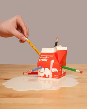 A hand sticking pencils into a milk carton, from photographer Olivia Locher's I Fought the Law series