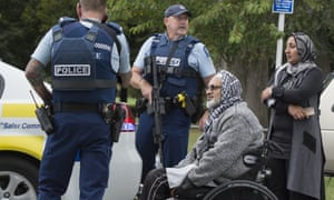Police speak with witnesses following a shooting at the Masjid Al Noor mosque in Christchurch