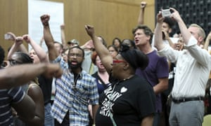 Protesters yell during the Charlottesville City Council meeting Monday, Aug. 21, 2017, in Charlottesville. Anger boiled over at the first Charlottesville City Council meeting since a white nationalist rally in the city descended into violent chaos, with some residents screaming and cursing at councilors Monday night and calling for their resignations.