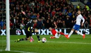 Goalkeeper Stojkovic is beaten but Gareth Bale's shot hits the post.