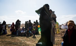 Women and children, believed to be Isis families, at a civilian screening point on the outskirts of Baghuz.
