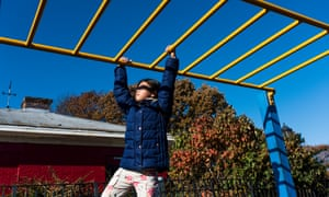 The chen's daughter plays in a park in south Brooklyn.