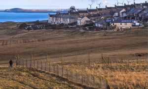 Site Of U.K. Government Backed New Coal Mine<br>A pedestian walks along the coast path beside the proposed site of a new coal mine in Whitehaven, U.K., on Monday, Feb. 8, 2021. The U.K. government backed the new mine which is expected to receive permission to keep digging till 2049-just one year before the U.K.'s legally mandated deadline to reach net-zero greenhouse gas emissions. Photographer: Anthony Devlin/Bloomberg via Getty Images