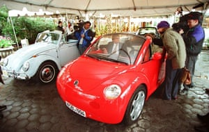 News media get a look at the new Volkswagen Concept 1 Cabriolet convertible 29 March 1994 in New York, NY before it is unveiled at the New York Auto Show.