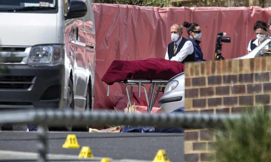 The body of Numan Haider is removed from the scene of his attack on two police officers, in which he was shot dead in the suburb of Endeavour Hills on 24 September 2014.