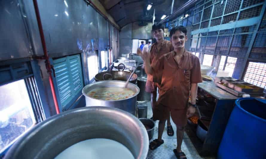 Kitchen staff cook on an Indian Railways train.