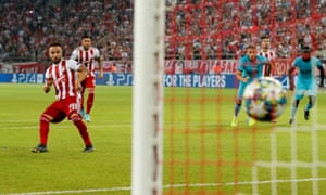 Olympiakos's Mathieu Valbuena scores his side's second goal from the penalty spot to level things up against Tottenham.