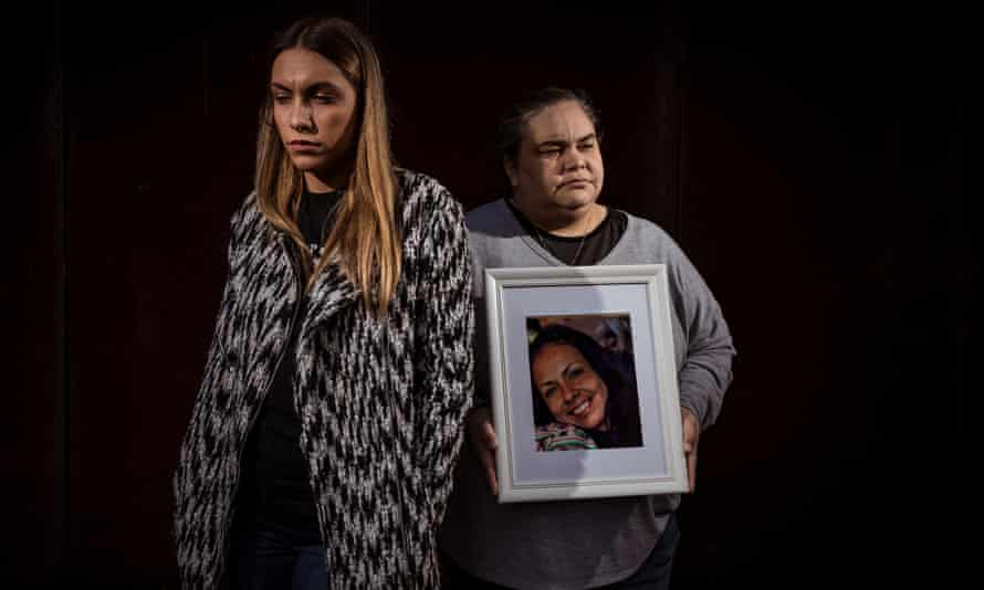 Tanya Day's daughters Apryl Watson and Belinda Stevens with a photo of their mother