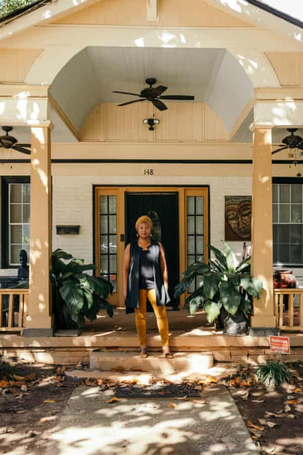 Tanya Washington in front of her home.