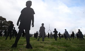 Silhouettes of children on the front lawns of Parliament House, Canberra, to represent asylum seeker children held on Nauru.