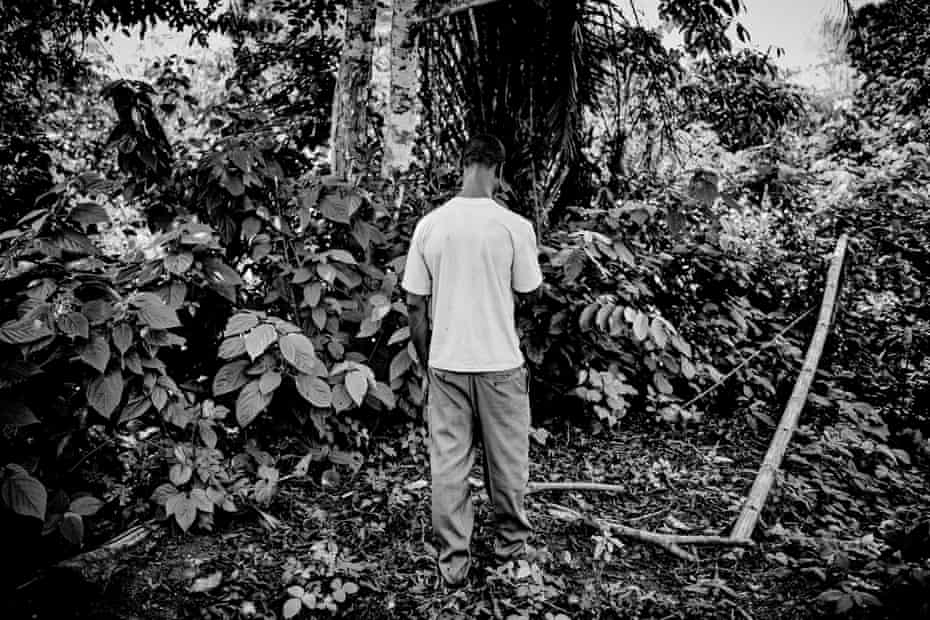 Dennis Anyaka stands in front of a tree