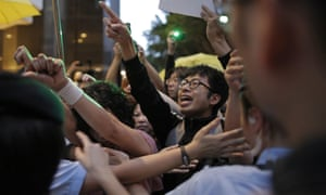 Pro-democracy activists are blocked by policewomen in Hong Kong.