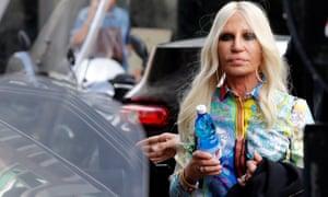 Italian designer Donatella Versace arrives to meet employees in Milan, Italy, September 25.