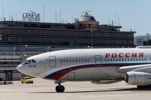 The Ilyushin Il-96 plane carrying Vladimir Putin taxis on Cointrin airport runway in Switzerland