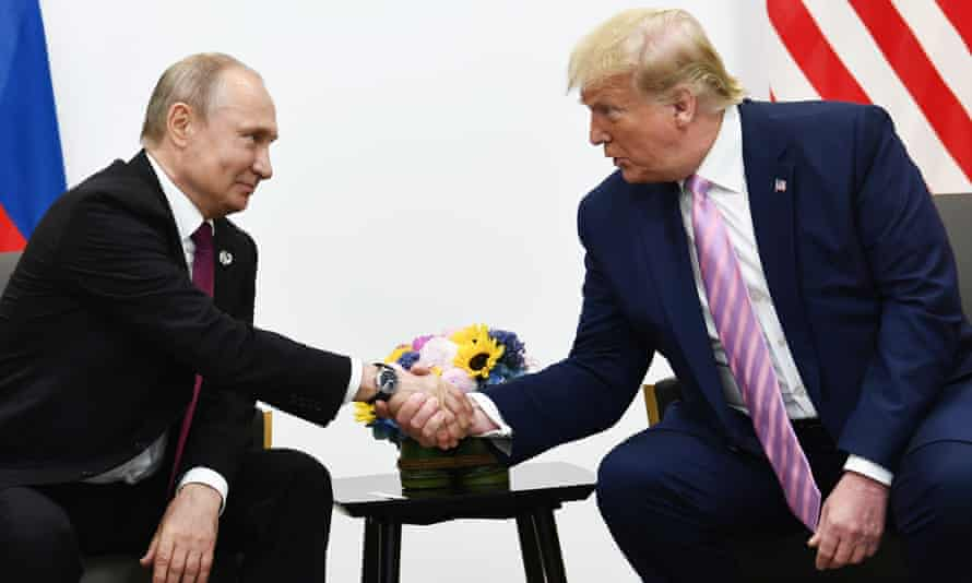 Donald Trump attends a meeting with Vladimir Putin during the G20 summit in Osaka in June 2019.