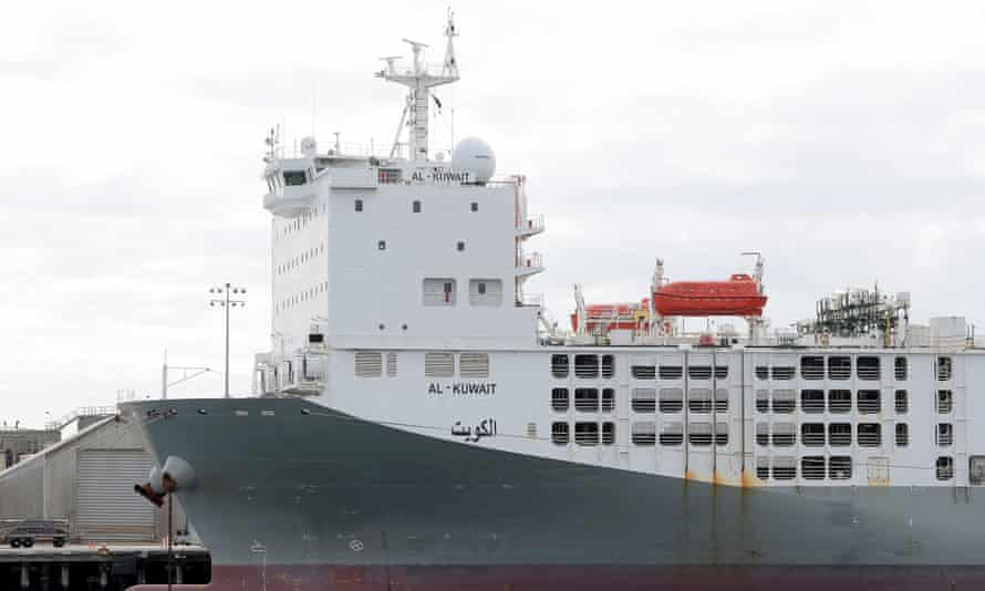 big cargo ship docked at port