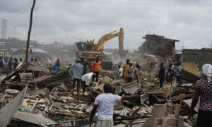 A bulldozer tears through a house in Badia East, an informal settlement in Lagos, Nigeria that has been destroyed without any support for the residents.
