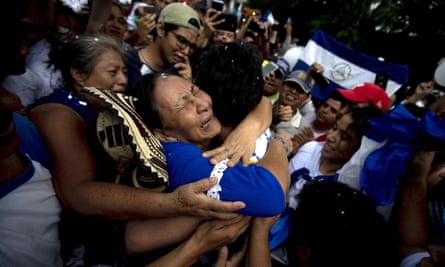 Ana Julia Urbina, mother of opposition leader Yubrank Suazo, cries as she hugs her son, who was released from prison, in Masaya, Nicaragua, on Tuesday.
