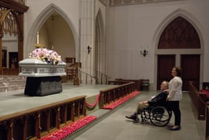 """George HW Bush looks at the casket with his daughter Dorothy """"Doro"""" Bush Koch."""