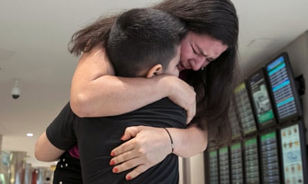 Andy, 7, is reunited with his mother, Arely, at Baltimore-Washington international airport 23 July 2018. They had been separated upon entering the US.