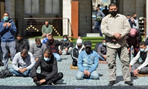 Men attend prayers at al-Husseini mosque in Amman, Jordan where stricter measures to curb the spread of coronavirus have been announced.