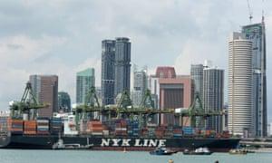 A container ship passes through Singapore harbour