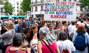 """Teachers on strike with a banner reading: """"No to the destruction of the education system, to parcoursup [an online system for graduated students applying to universities] and to Blanquer's reforms"""" in Paris."""