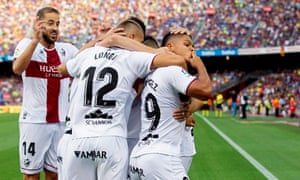 Cucho Hernández celebrates with his Huesca team-mates, but their joy was short-lived.