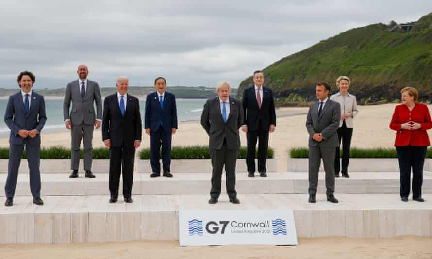 The G7 leaders pose for a group photo at Carbis Bay in Cornwall