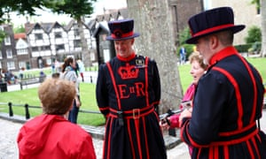 Beefeaters chat to tourists at the Tower of London