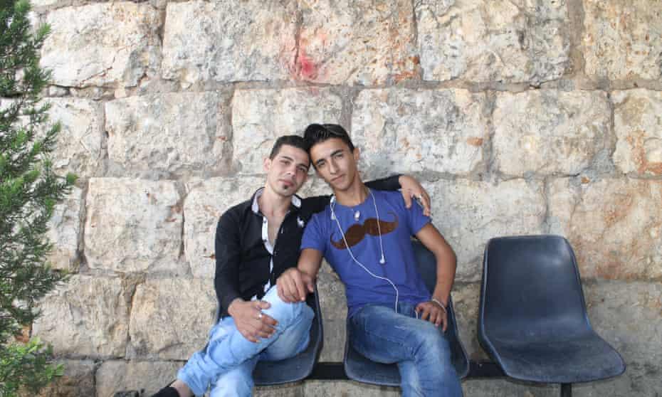 Friends Ali Amoun and Khidr Mukhaiber live in opposing neighbourhoods.