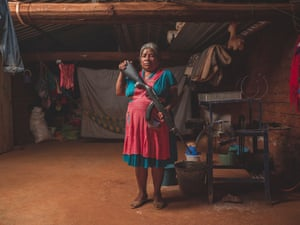 Portrait of a volunteer of the police community of CRAC-PF in her house, in Rincon De Chautla. Women and children have taken up arms after the several attacks by the criminal group of Los Ardillos.