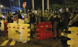 Riot police erect barriers outside the metro station