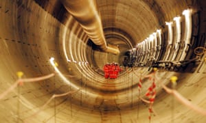 What lies beneath … workers inspect the first completed section of the Crossrail tunnel.
