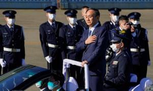 Japanese Prime Minister Yoshihide Suga reviews Japan's Air Self-Defense Force personnel at Iruma Air Base in Sayama, Saitama Prefecture, Japan, 28 November 2020.
