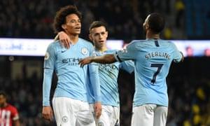 Leroy Sane celebrates making it 6-1 Manchester City.