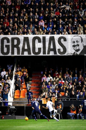 Valencia CF's supporters hang a banner on the stands to show their support to Real Madrid's coach Rafa Benitez.